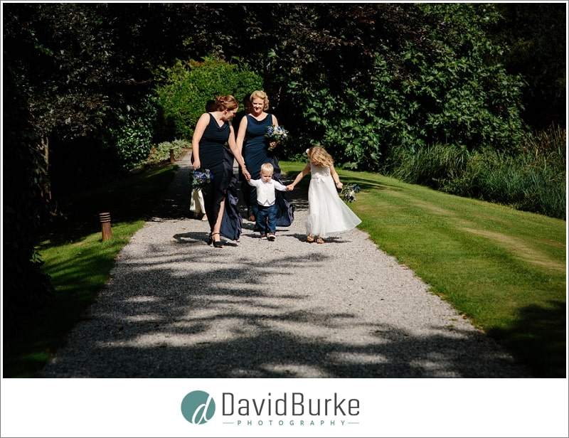 bride walking to ceremony at the orangery