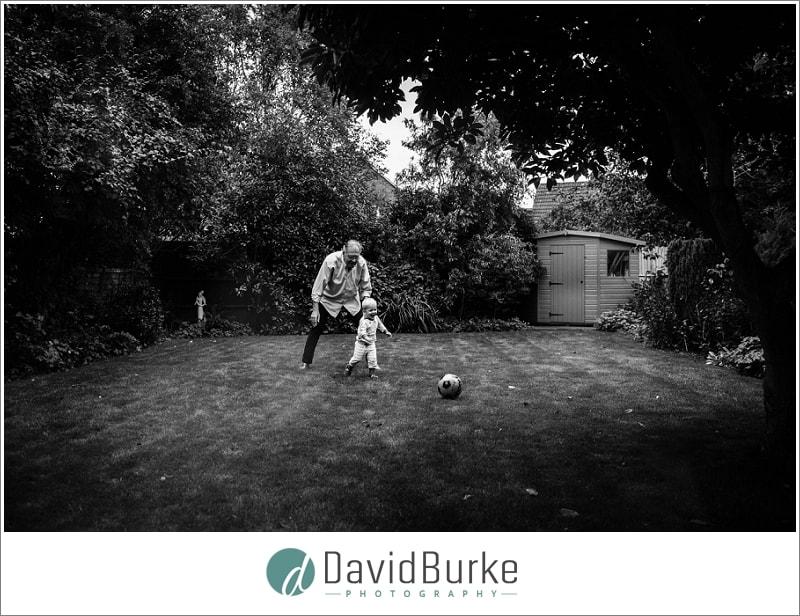 grandad and grandson paying football