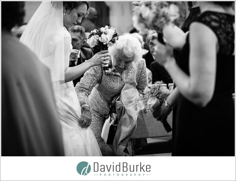 granny admiring brides dress