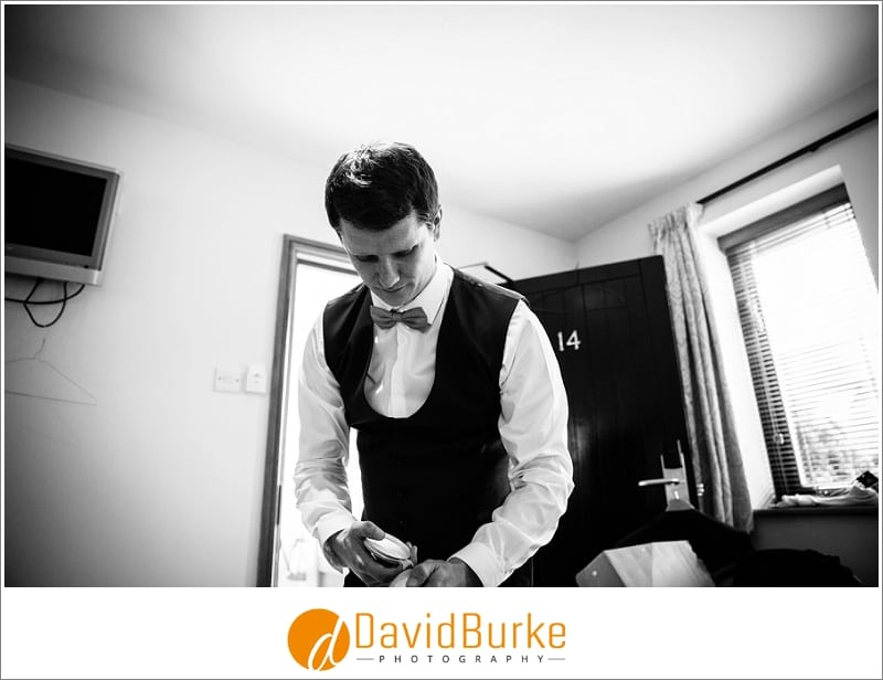 bestman getting ready at cooling castle barns