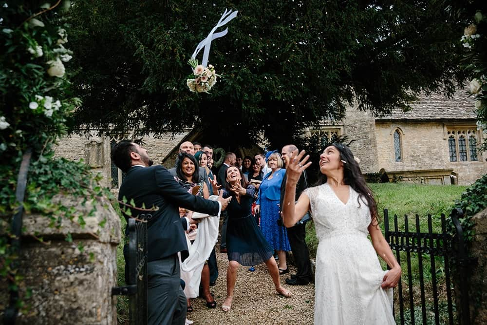 Throwing the bouquet - Kent Wedding Photographer