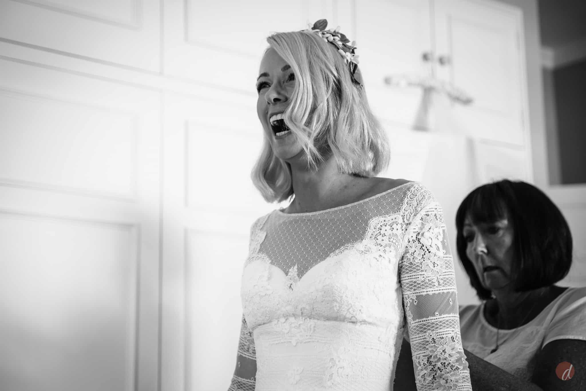 laughing bride in her wedding dress