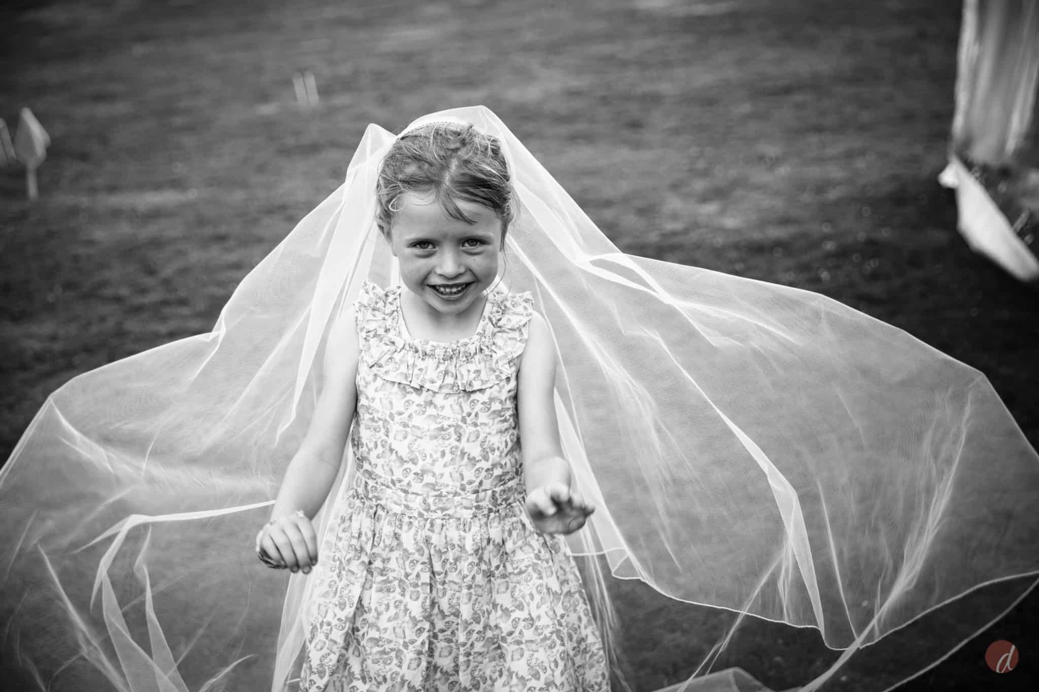 little girl in brides veil